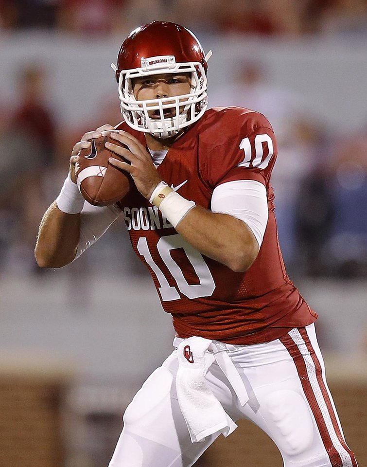Oklahoma\'s Blake Bell (10) drops back to pass during the college football game between the University of Oklahoma Sooners (OU) and Florida A&M Rattlers at Gaylord Family—Oklahoma Memorial Stadium in Norman, Okla., Saturday, Sept. 8, 2012. Photo by Bryan Terry, The Oklahoman