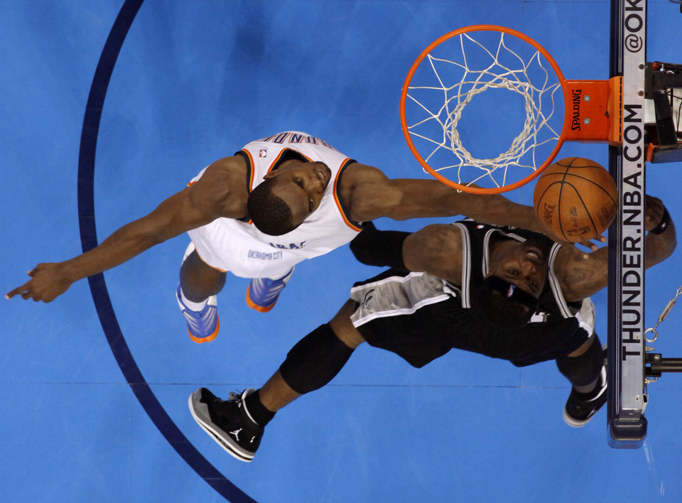 Oklahoma City\'s Serge Ibaka (9) defends San Antonio\'s Stephen Jackson (3) during Game 4 of the Western Conference Finals between the Oklahoma City Thunder and the San Antonio Spurs in the NBA playoffs at the Chesapeake Energy Arena in Oklahoma City, Saturday, June 2, 2012. Oklahoma CIty won 109-103. Photo by Bryan Terry, The Oklahoman
