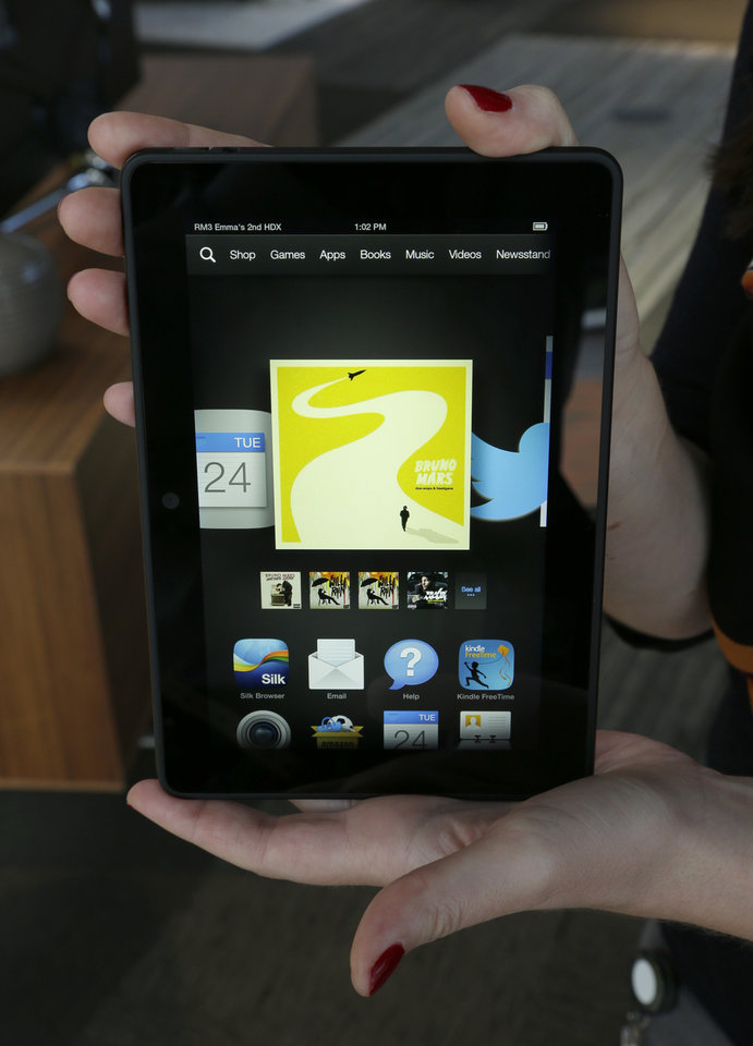 Photo - FILE - This Sept. 24, 2013 file photo shows the 7-inch Amazon Kindle HDX tablet computer, in Seattle. (AP Photo/Ted S. Warren, File)