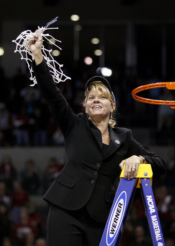 Photo - OU coach Sherri Coale cuts down the net after OU's win in the NCAA women's basketball regional  tournament finals between Oklahoma and Purdue at the Ford Center in Oklahoma City, Tuesday, March 31, 2009.  OU won, 74-68. Photo by Bryan Terry, The Oklahoman