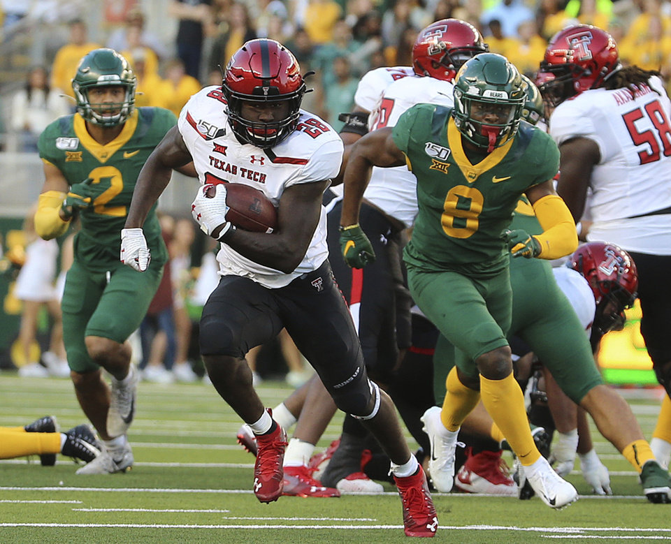 Photo - Texas Tech running back SaRodorick Thompson (28) runs past the Baylor defense for a touchdown during the second half of a NCAA college football game in Waco, Tex.,Saturday, Oct. 12, 2019.(AP Photo/Jerry Larson)