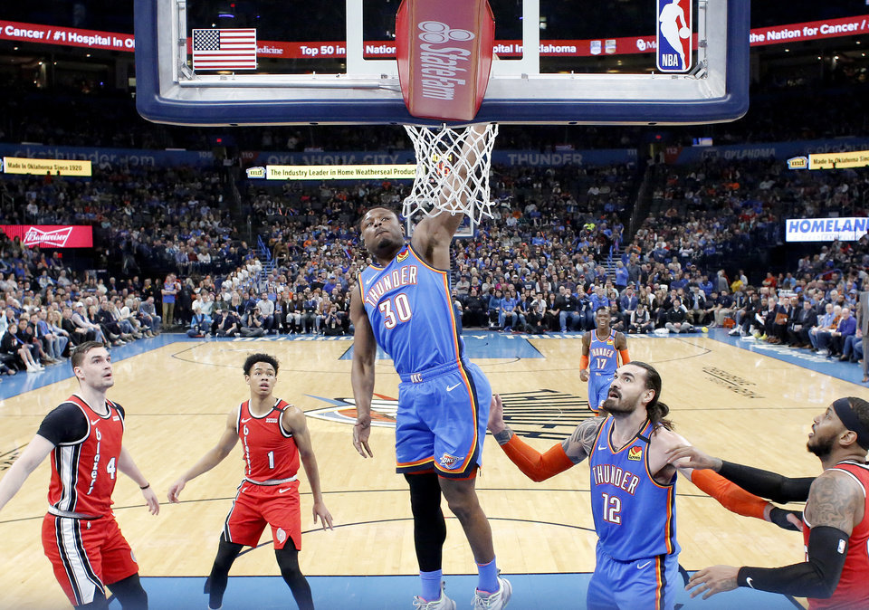 Photo - Oklahoma City's Deonte Burton (30) dunks the ball during the NBA basketball game between the Oklahoma City Thunder and the Portland Trail Blazers at the Chesapeake Energy Arena in Oklahoma City, Saturday, Jan. 18, 2020.  [Sarah Phipps/The Oklahoman]