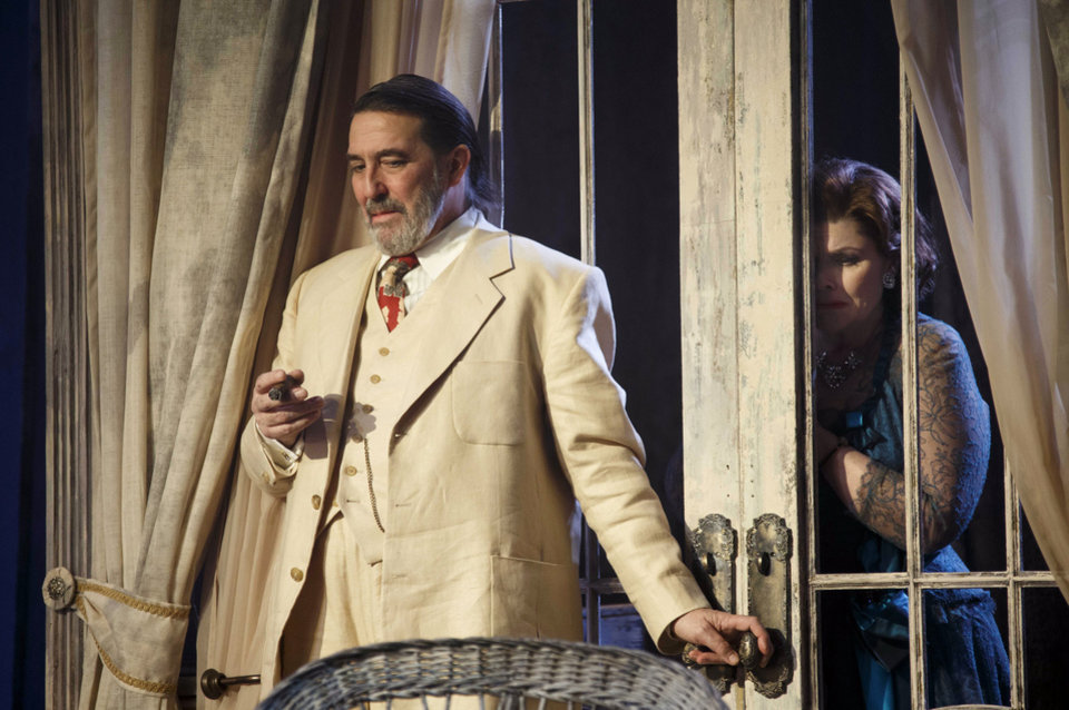 Photo - This undated theater image released by Boneau/Bryan-Brown shows Ciaran Hinds, left, and Debra Monk during a performance of