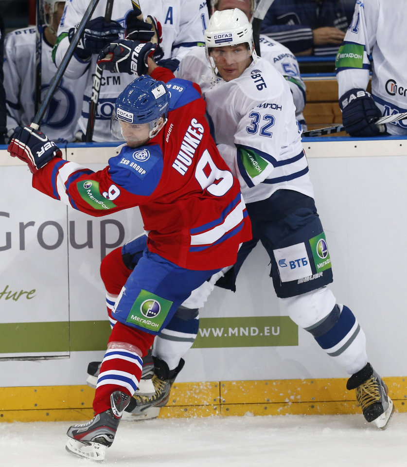 Photo -   Alexander Ovechkin, right, from Dynamo Moscow collides with Jiri Hunkes, left, from Lev Praha during their KHL ice hockey match in Prague, Czech Republic, Tuesday, Oct. 9, 2012. Ovechkin is among those NHL players who were signed by European clubs because of the NHL lockout. (AP Photo/Petr David Josek)