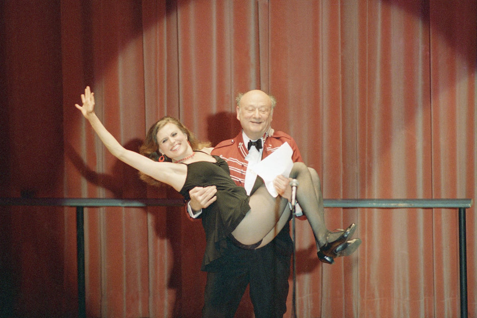 FILE - In this March 8, 1987, file photo, New York Mayor Ed Koch gives a lift to Broadway dancer Ann Reinking during a performance of political satire on at the annual Inner Circle gathering of the New York Press Club in New York. Koch, the combative politician who rescued the city from near-financial ruin during three City Hall terms, has died at age 88. Spokesman George Arzt says Koch died Friday morning Feb. 1, 2013 of congestive heart failure. (AP Photo/Richard Drew, File)