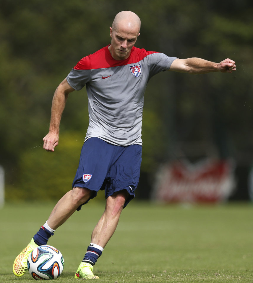 Photo - United States' Michael Bradley shoots during a training session at the Sao Paulo FC training center in Sao Paulo, Brazil, Wednesday, June 11, 2014. The U.S. will play in group G of the 2014 soccer World Cup. (AP Photo/Julio Cortez)