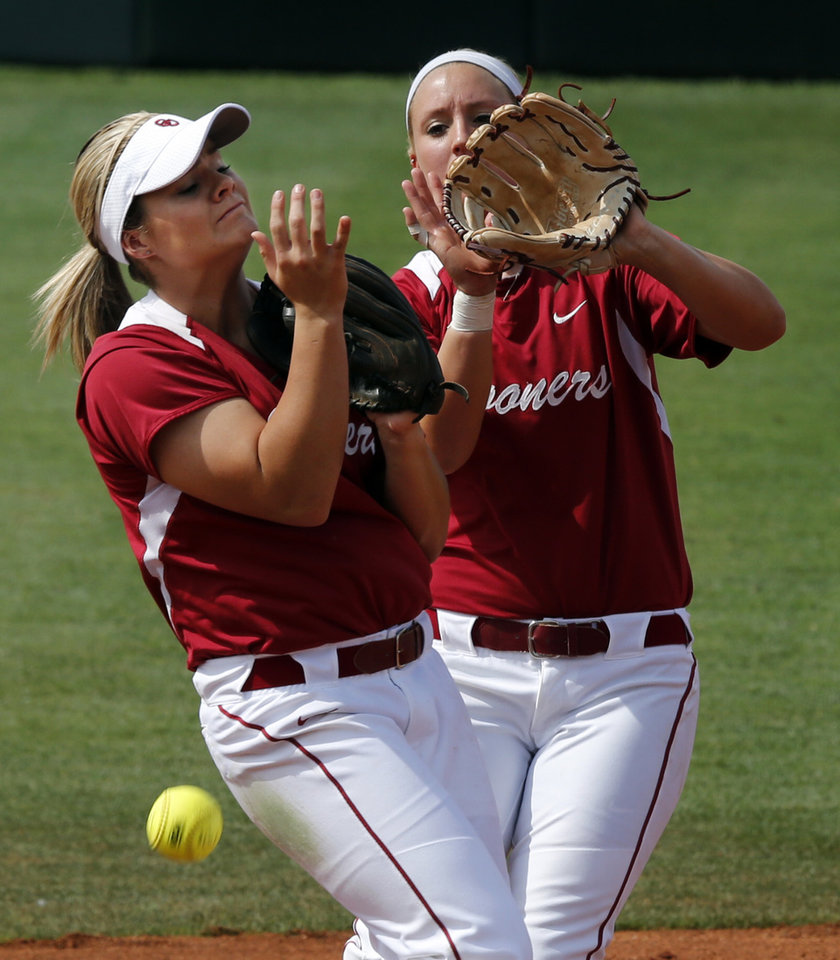 Photo - Oklahoma's Georgia Casey, left, and Javen Henson can't decide who should get a pop up for an error as the University of Oklahoma Sooner (OU) softball team plays Tennessee in game two of the NCAA super regional at Marita Hynes Field on May 24, 2014 in Norman, Okla. Photo by Steve Sisney, The Oklahoman