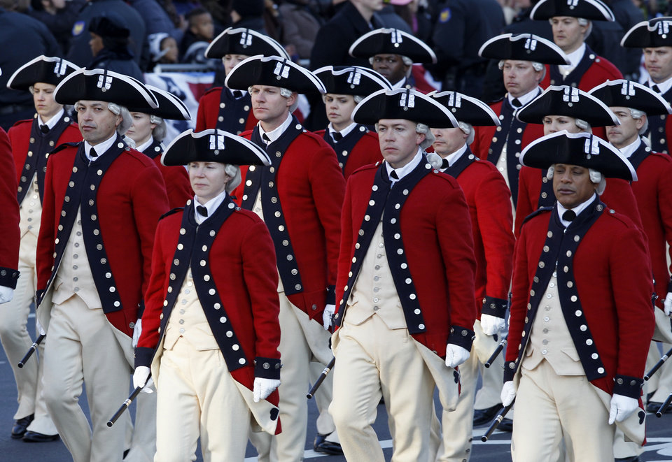 Photo - The Army's Old Guard Fife and Drum Corps march in President Barack Obama's inaugural parade in Washington, Monday,Jan. 21, 2013, following the president's ceremonial swearing-in ceremony during the 57th Presidential Inauguration.  ( AP Photo/Jose Luis Magana) ORG XMIT: DCJL124