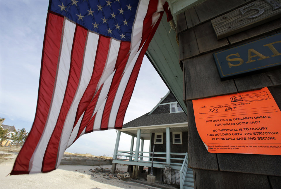 FILE - In this Jan. 3, 2013, file photo, an unsafe for human occupancy sticker is attached to a home that was severely damaged by Superstorm Sandy in Bay Head, N.J. Conservatives and watchdog groups are mounting a