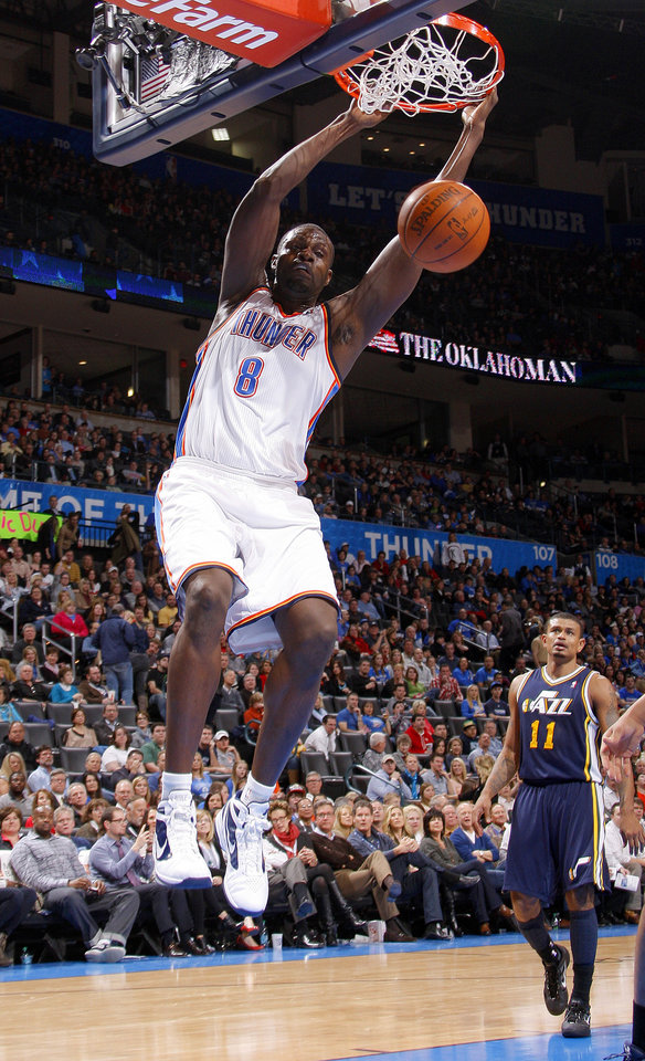 Oklahoma City's Nazr Mohammed (8) dunks the ball as Utah's Earl Watson (11) watches during an NBA game between the Oklahoma City Thunder and the Utah Jazz at Chesapeake Energy Arena in Oklahoma CIty, Tuesday, Feb. 14, 2012. Photo by Bryan Terry, The Oklahoman