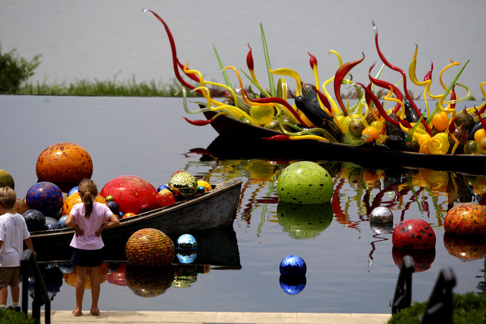 Visitors look at a boat full of blown glass forms that are part of an exhibit of Dale Chihuly's art at the Dallas Arboretum on Friday, May 4, 2012. Photo by Bryan Terry, The Oklahoman <strong>BRYAN TERRY</strong>