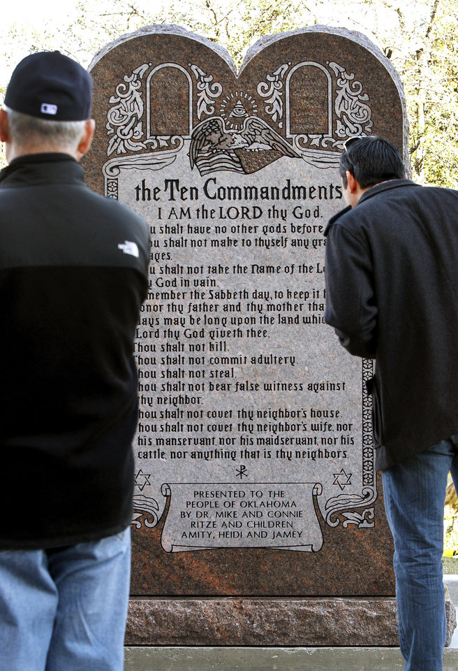 Two men step up to get a close look at this six-foot tall granite monument of the Ten Commandments  after it was  erected on the north side of the state Capitol grounds Thursday morning, Nov. 15, 2012.  Photo by Jim Beckel, The Oklahoman