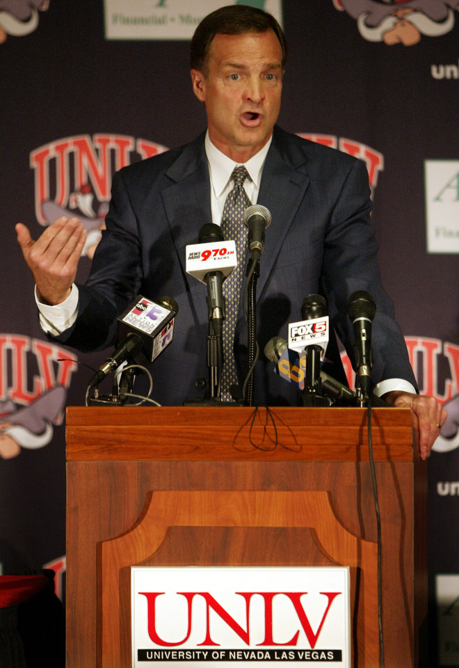 Photo - Lon Kruger speaks during a news conference Monday, March 15, 2004 at the Thomas & Mack Center in Las Vegas. Kruger was named the new head coach at UNLV. He has been a head coach with the NBA Atlanta Hawks and with several NCAA Division I schools including Illinois and Florida. (AP Photo/Joe Cavaretta)