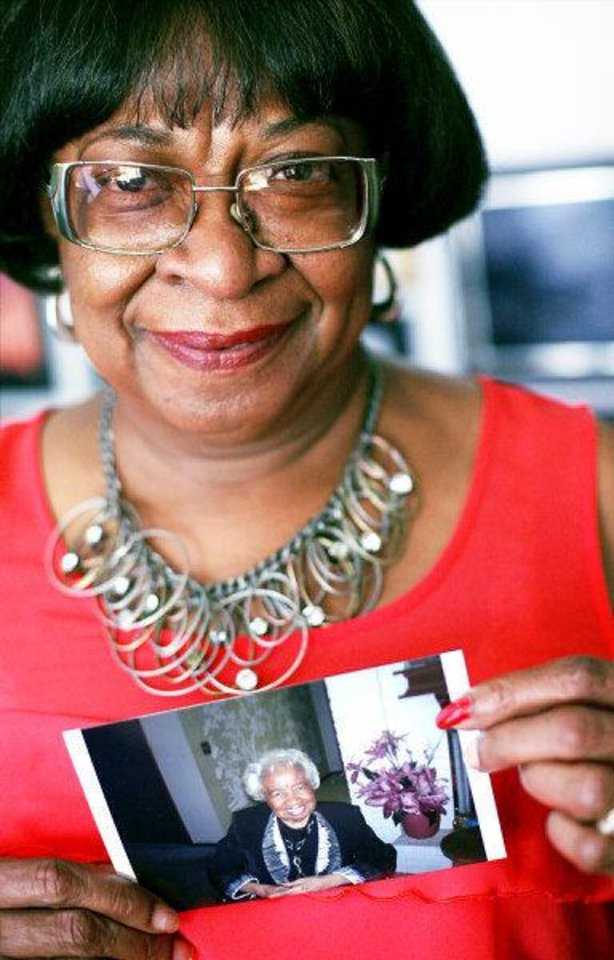 Photo - Marilyn Hildreth, of Oklahoma City, poses with one of her favorite pictures of her mother, Clara Luper, at her home in Oklahoma City on Wednesday, June 15, 2011. Clara Luper's funeral will be held on Friday, June 17, 2011. Photo by John Clanton, The Oklahoman ORG XMIT: KOD
