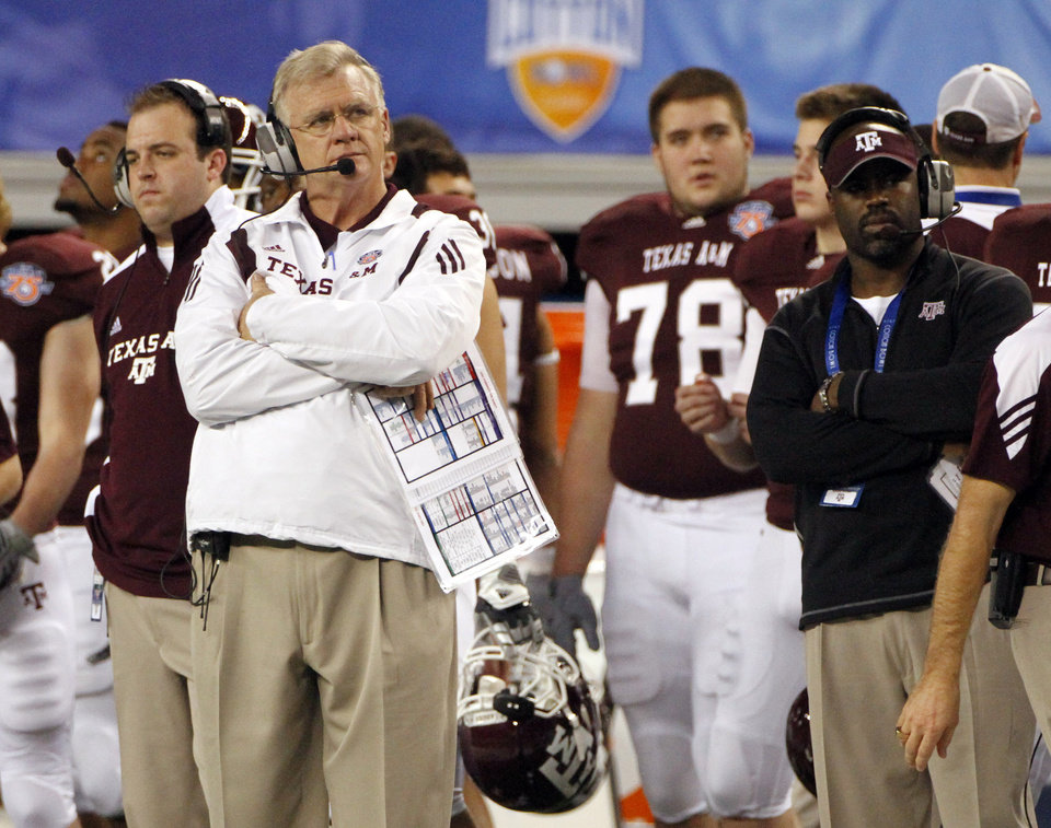 FILE - In this Jan. 7, 2011 file photo, Texas A&M head coach Mike Sherman, left looks on from the sideline during the second half of the Cotton Bowl NCAA college football game against LSU in Arlington, Texas.  Texas A&M considered a move to the Southeastern Conference last year before deciding to stay in the Big 12. Now many are wondering if the Aggies' days in the Big 12 are numbered, and what that could mean for the future of the conference.  (AP Photo/Tony Gutierrez, File) ORG XMIT: NY166