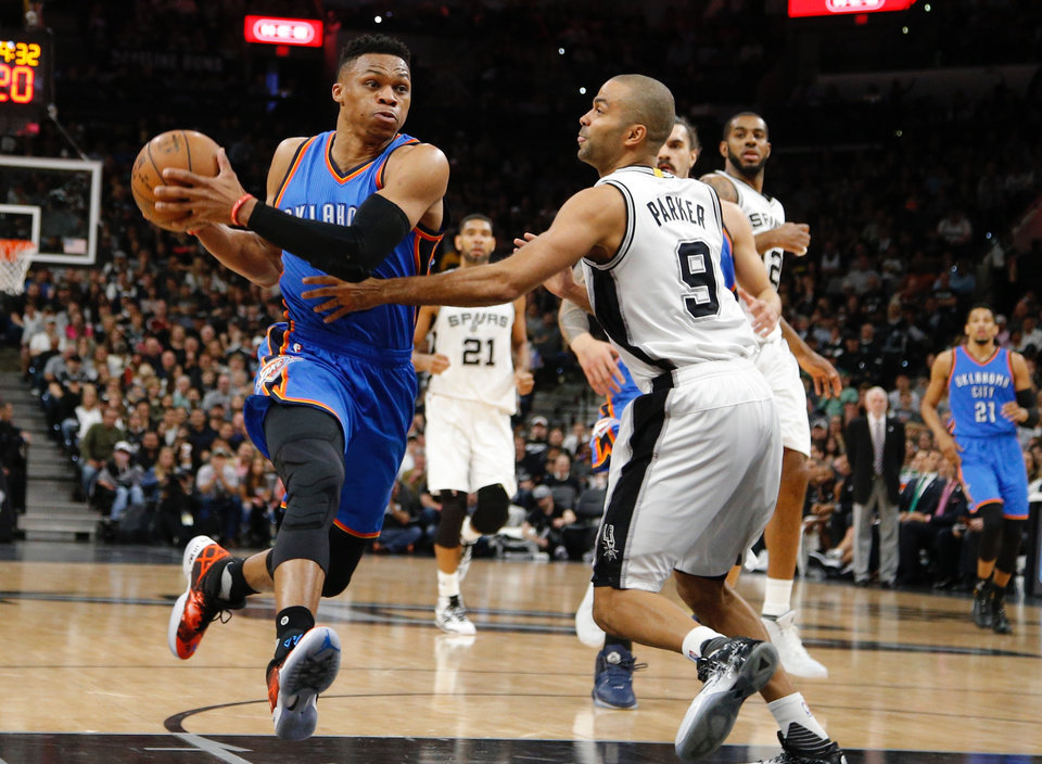 Photo - Oklahoma City's Russell Westbrook goes past San Antonio's Tony Parker during Game 2 of the second-round series between the Oklahoma City Thunder and the San Antonio Spurs in the NBA playoffs at the AT&T Center in San Antonio, Monday, May 2, 2016. Photo by Bryan Terry, The Oklahoman