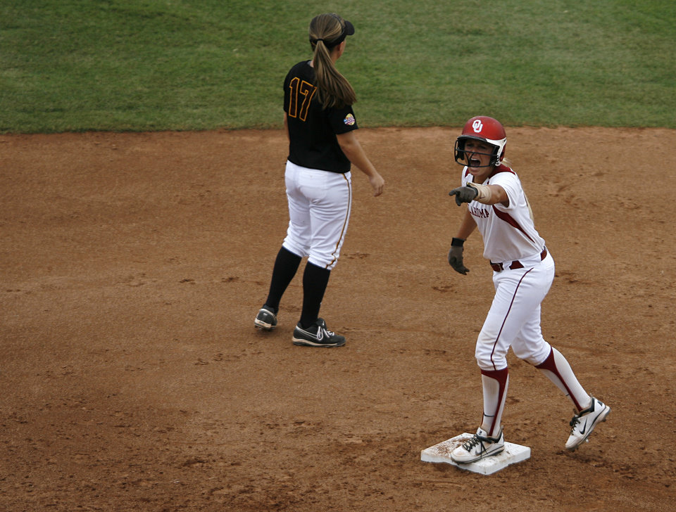 Oklahoma's Jessica Shults (18) reacts during a Women's College World Series game between Oklahoma University and Arizona State University at ASA Hall of Fame Stadium in Oklahoma City, Sunday, June 3, 2012.  Photo by Garett Fisbeck, The Oklahoman