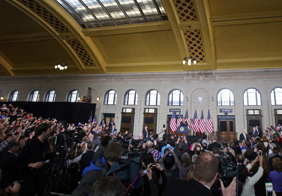 Photo - President Barack Obama speaks at the historic Union Depot in St. Paul, Minn., Wednesday, Feb. 26, 2014, where he announced a new competition encouraging investments for job creation and infrastructure as part of his