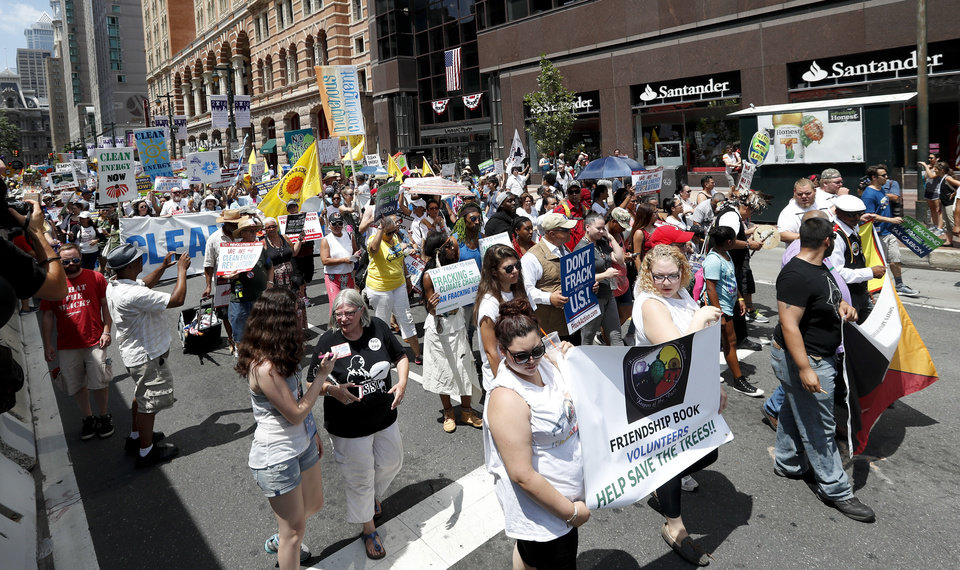 Photo - Environmental protesters march in downtown on Sunday, July 24, 2016, in Philadelphia. The Democratic National Convention starts Monday in Philadelphia. (AP Photo/Alex Brandon)