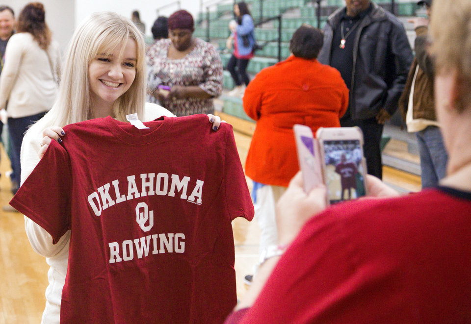 Photo - Norman North's Casey Mulligan poses for a photo after signing her letter of intent to row for the University of Oklahoma during national signing day at Norman North High School in Norman, Okla. on Wednesday, Feb. 7, 2018.  Photo by Chris Landsberger, The Oklahoman