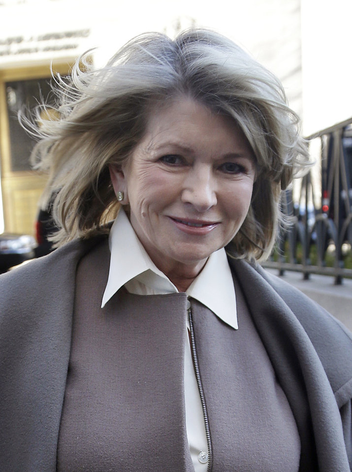 Photo - Martha Stewart arrives to court in New York, Tuesday, March 5, 2013. Macy's Inc. is suing the media and merchandising company Stewart founded for breaching an exclusive contract when she signed a deal with J.C. Penney in December 2011 to open shops at most of its stores this spring.(AP Photo/Seth Wenig)