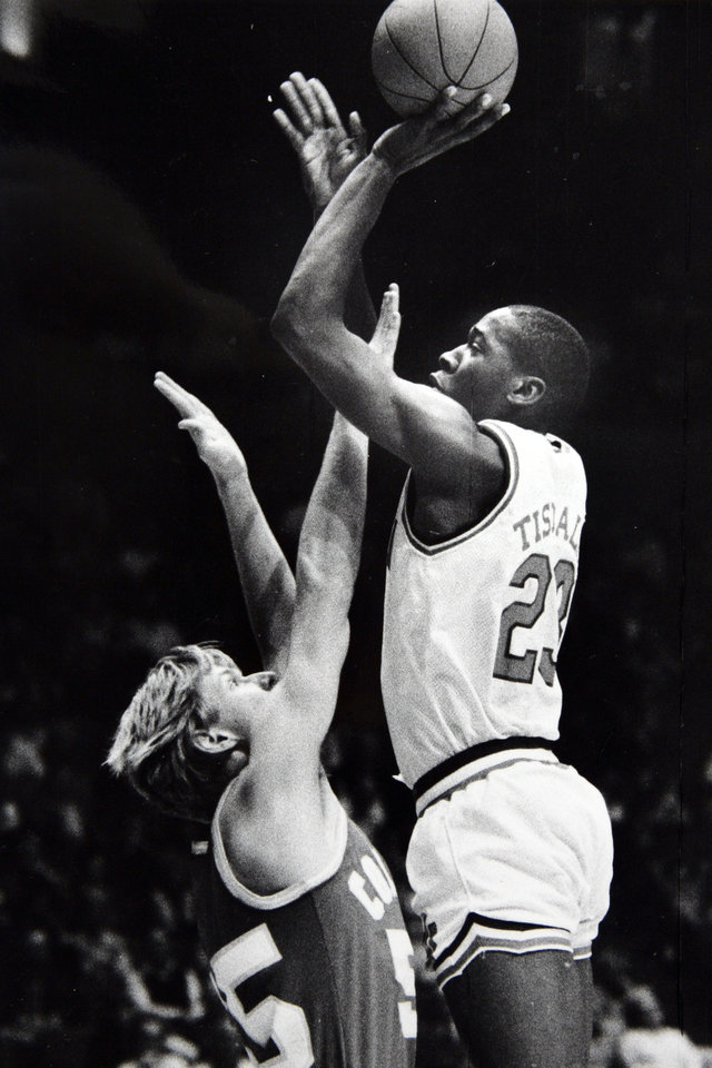 Photo - Former OU basketball player Wayman Tisdale. OU's Wayman Tisdale has his shot out of Don Yowell's reach. Staff Photo by Paul Hellstern  Photo taken 1/29/1983, published unknown ORG XMIT: KOD