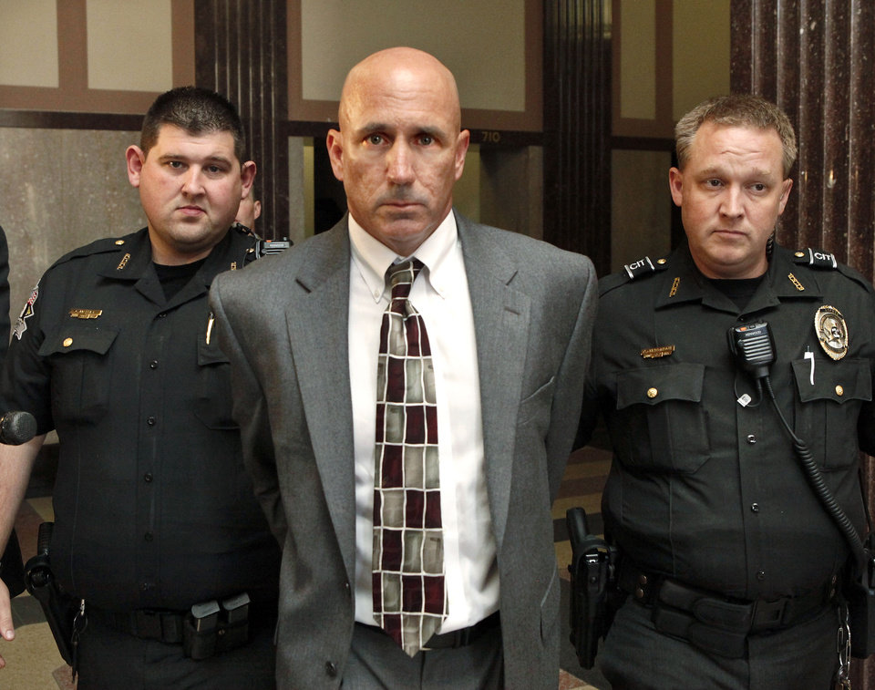 Photo - Former Western Heights High School coach Michael Hestand, who pleaded guilty to taking clandestine photos of softball players changing clothes in a locker room at the school, was sentenced to 17 years in prison by District Judge Ray Elliott on Thursday. Photo by Jim Beckel, The Oklahoman