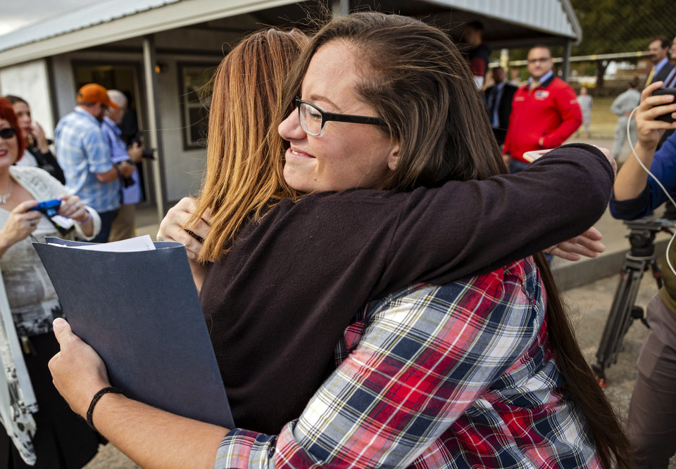 Photo - Danni Roberts, right, hugs her mother Veronica Hughes after Roberts was released from the Dr. Eddie Warrior Correctional Facility on Monday, Nov. 4, 2019 in Taft, Okla. Governor Kevin Stitt greeted an estimated 70 women whose sentences he commuted from the facility. [Chris Landsberger/The Oklahoman]