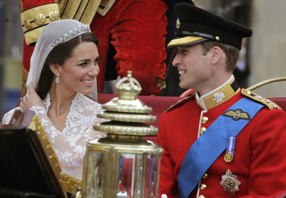 Photo - Britain's Prince William and his wife Kate, Duchess of Cambridge, left, smiles as they leave Westminster Abbey at the Royal Wedding in London Friday, April 29, 2011. (AP Photo/Gero Breloer)  ORG XMIT: RWFO147