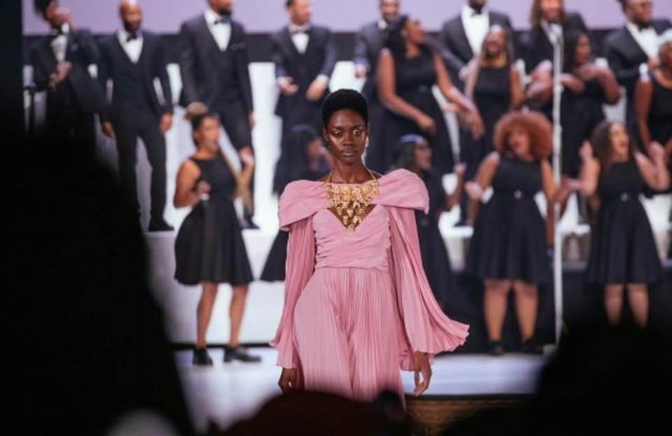 "Photo - Photo by Kevin Hagen/AP/Shutterstock  The Pyer Moss collection is modeled during Fashion Week, in New York. The show featured a choir singing renditions of ""Cardi B's ""Money"" and Tina Turner's ""Proud Mary."""