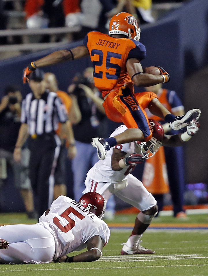 Photo - UTEP Miners running back Nathan Jeffery (25) leaps over Oklahoma Sooners defensive back Demontre Hurst (6) and Oklahoma Sooners linebacker Joseph Ibiloye (5) during the college football game between the University of Oklahoma Sooners (OU) and the University of Texas El Paso Miners (UTEP) at Sun Bowl Stadium on Saturday, Sept. 1, 2012, in El Paso, Tex.  Photo by Chris Landsberger, The Oklahoman