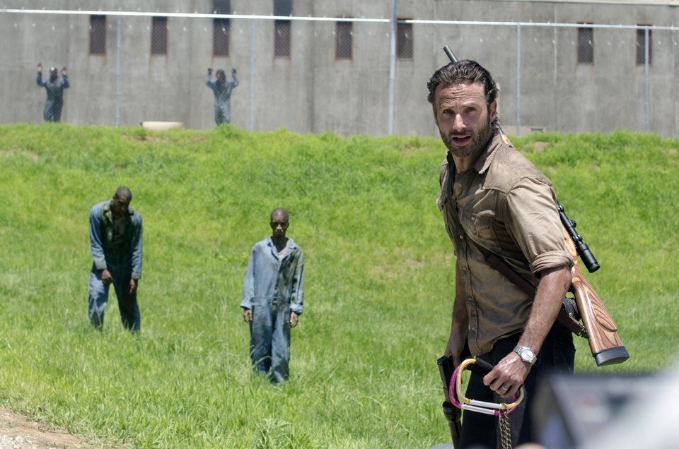 "This image released by AMC shows Andrew Lincoln as Sheriff Rick Grimes in a scene from the season three premiere episode of ""The Walking Dead,"" premiering Sunday at 9p.m. EST on AMC. (AP Photo/AMC, Gene Page) ORG XMIT: NYET221"