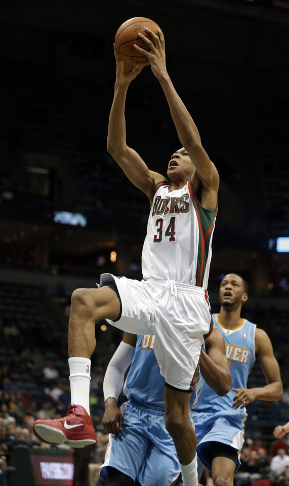 Photo - Milwaukee Bucks' Giannis Antetokounmpo (34) dunks against the Denver Nuggets during the second half of an NBA basketball game Thursday, Feb. 20, 2014, in Milwaukee. (AP Photo/Jeffrey Phelps)