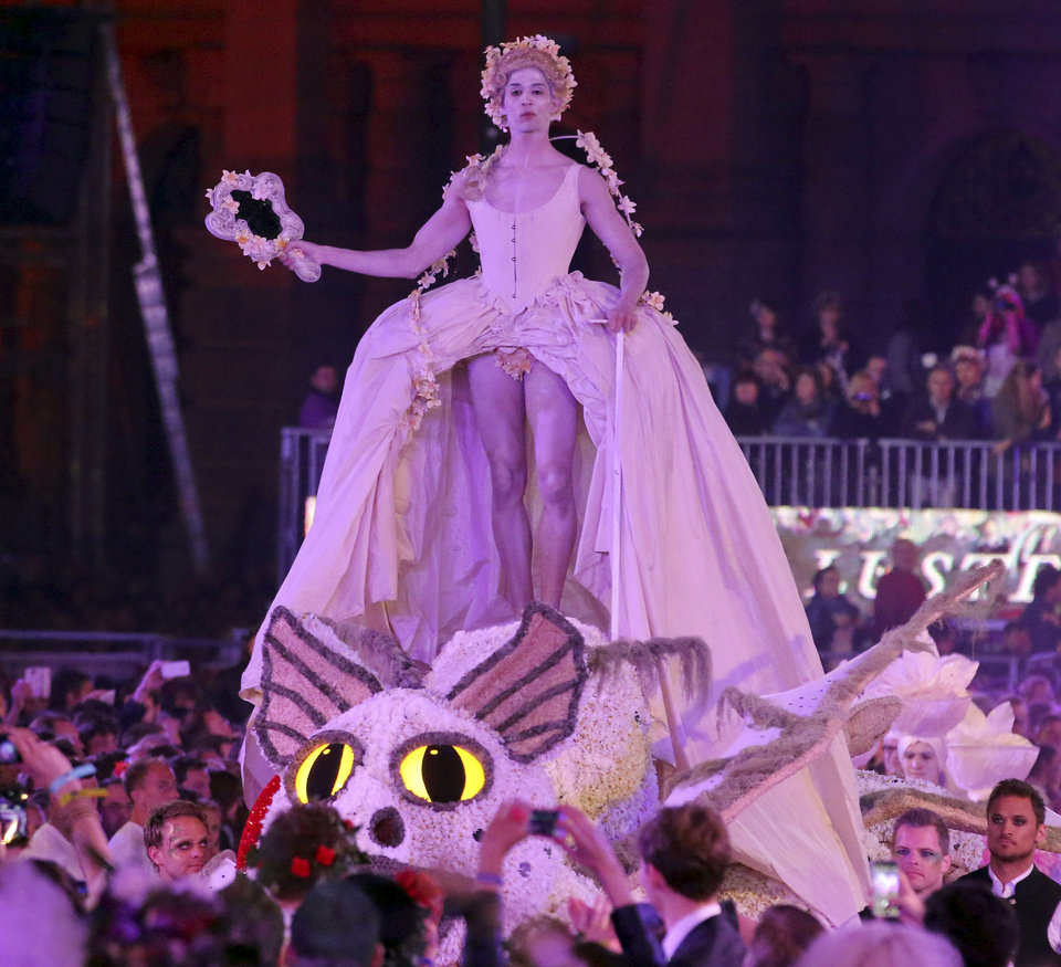 Photo - Models performs on stage during the opening ceremony of the Life Ball in front of City Hall in Vienna, Austria, Saturday, May 31, 2014. The Life Ball is a charity gala to raise money for people living with HIV and AIDS. (AP Photo/Ronald Zak)