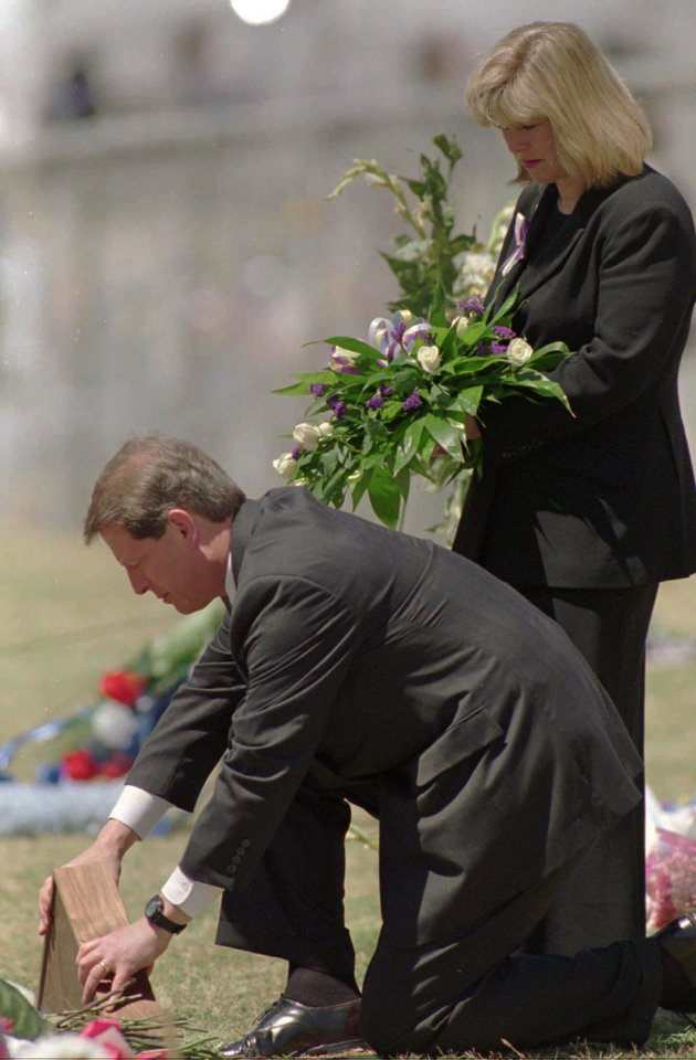 Photo - On the first anniversary of the 1995 bombing, then-Vice President Al Gore lays an American flag on the area where the Alfred P. Murrah Federal Building once stood. Holding the flowers is his wife, Tipper.  AP file PhotO  DAVID L. LONGSTREATH - AP -  Associated Press