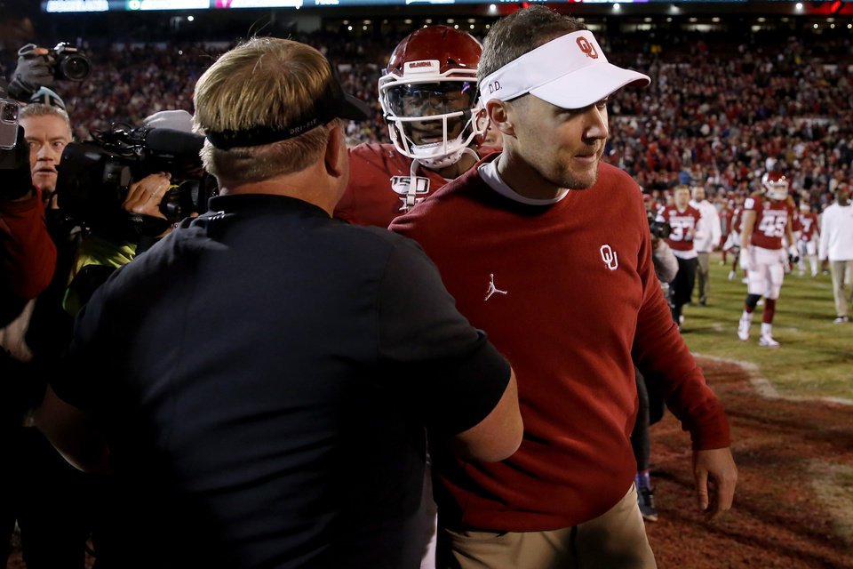 Photo - Oklahoma coach Lincoln Riley greets TCU coach Gary Patterson after an NCAA football game between the University of Oklahoma Sooners (OU) and the TCU Horned Frogs at Gaylord Family-Oklahoma Memorial Stadium in Norman, Okla., Saturday, Nov. 23, 2019. Oklahoma won 28-24. [Bryan Terry/The Oklahoman]