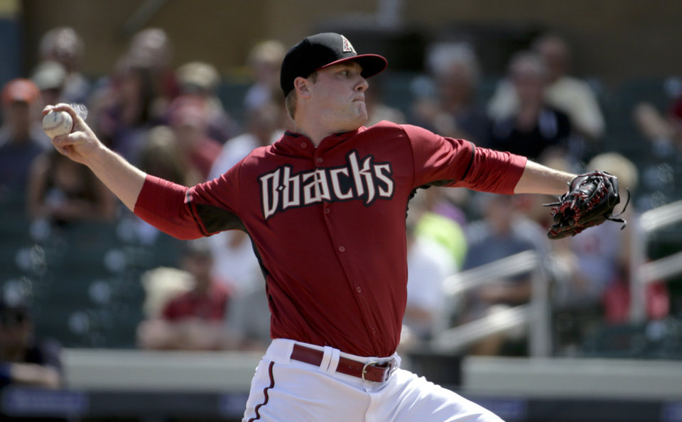 Photo - Arizona Diamondbacks starting pitcher Archie Bradley throws to the Seattle Mariners during the first inning of a spring exhibition baseball game in Scottsdale, Ariz., Thursday, March 13, 2014. (AP Photo/Chris Carlson)