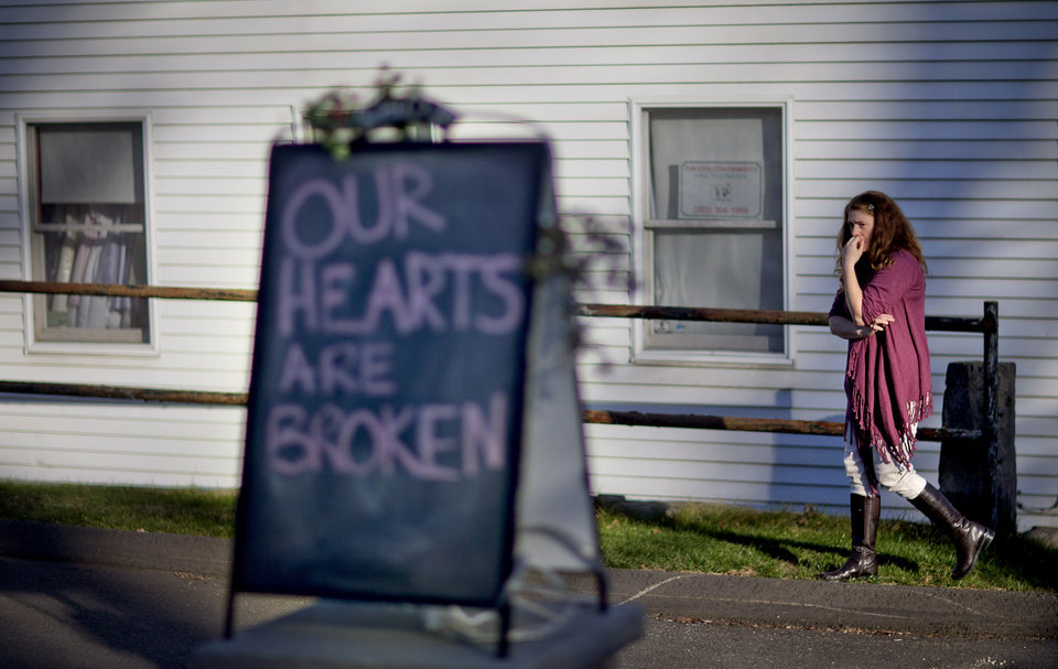 Shop owner Tamara Doherty paces outside her store just down the road from Sandy Hook Elementary School, Saturday, Dec. 15, 2012, in Newtown, Conn. The massacre of 26 children and adults at the school elicited horror and soul-searching around the world even as it raised more basic questions about why the gunman, 20-year-old Adam Lanza, would have been driven to such a crime and how he chose his victims. (AP Photo/David Goldman) ORG XMIT: CTDG117