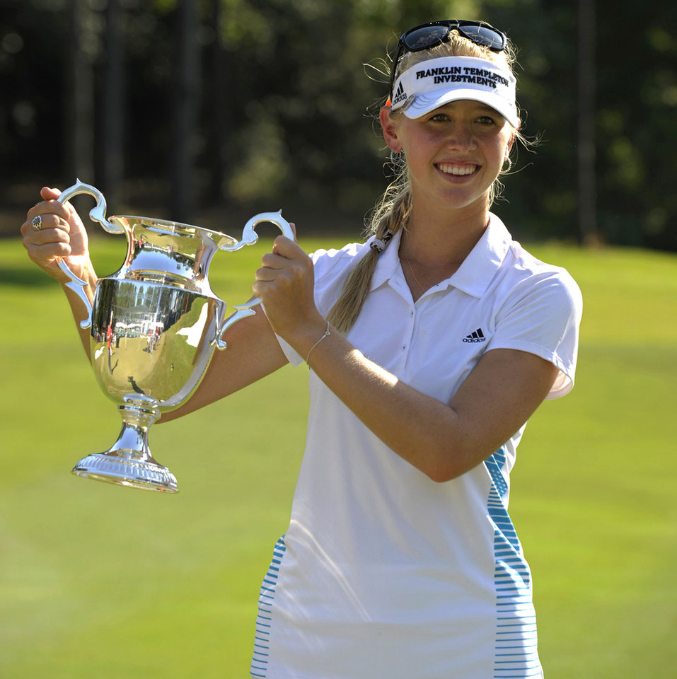Photo - Jessica Korda holds up the trophy following her win in the Airbus LPGA Classic golf tournament at Magnolia Grove on Sunday, May 25, 2014, in Mobile, Ala. (AP Photo/G.M. Andrews)