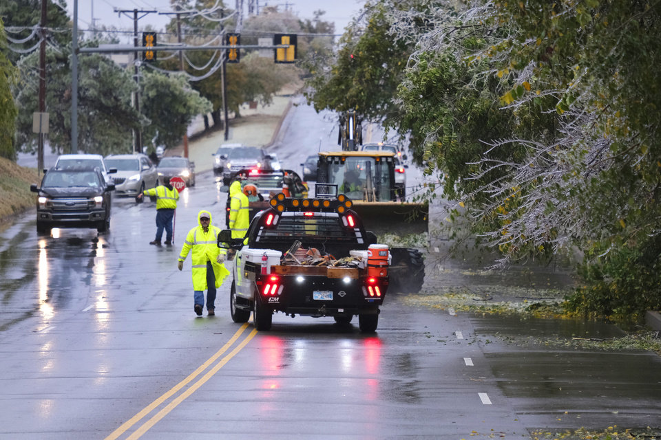 Photo - Edmond Field Service crews clear 15th St. near Rankin Blvd. from the ice storm that hit the Oklahoma City metro area Tuesday, October 27, 2020. [Doug Hoke/The Oklahoman]