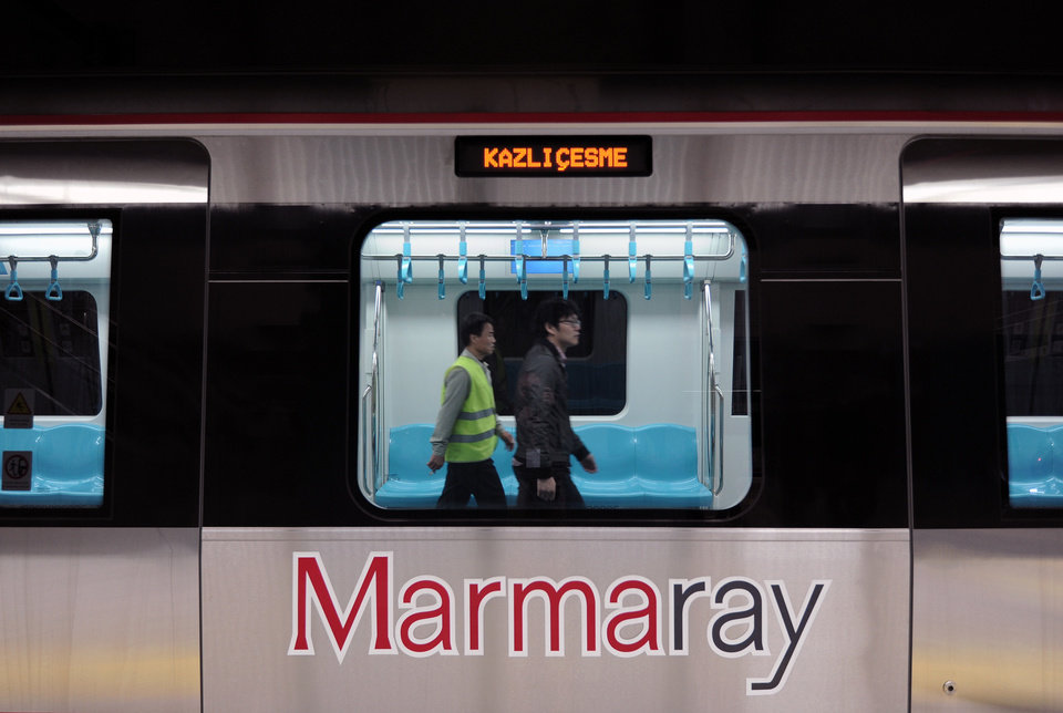 Photo - Two Japanese technicians  walk inside a train for the inauguration of the tunnel called Marmaray in Istanbul, Turkey, Tuesday, Oct. 29, 2013. Turkey is for the first time connecting its European and Asian sides with a railway tunnel set to open Tuesday, completing a plan initially proposed by an Ottoman sultan about 150 years ago. The  Marmaray, is among a number of large infrastructure projects under the government of Prime Minister Recep Tayyip Erdogan that have helped boost the economy but also have provoked a backlash of public protest.(AP Photo)
