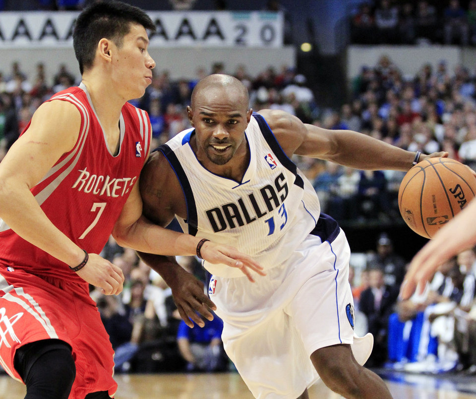 Dallas Mavericks point guard Mike James (13) tries to get around Houston Rockets guard Jeremy Lin (7) during the fourth quarter of a NBA basketball game, Wednesday, Jan. 16, 2013, in Dallas. The Mavericks won 105-100. (AP Photo/John F. Rhodes)