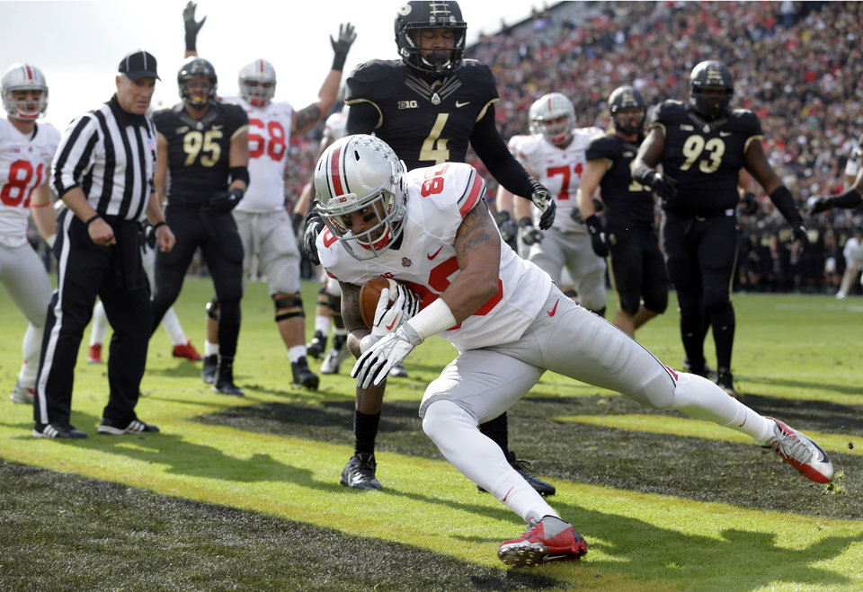 Photo - Ohio State wide receiver Chris Fields scores a touchdown on a catch against Purdue during the first half of an NCAA college football game in West Lafayette, Ind., Saturday, Nov. 2, 2013. (AP Photo/Michael Conroy)