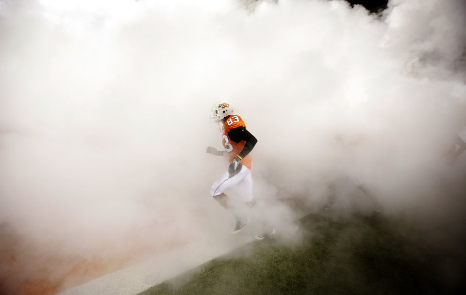 Photo - OSU's Dameron Fooks (83) runs on the field before the college football game between Oklahoma State University (OSU) and Texas Tech University (TTU) at Boone Pickens Stadium in Stillwater, Okla. Saturday, Nov. 14, 2009. Photo by Sarah Phipps, The Oklahoman