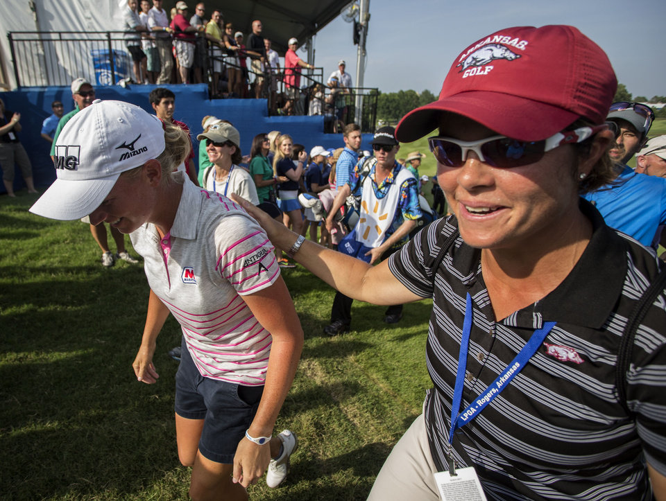 Photo - Stacy Lewis, left, is greeted by her former coach and current University of Arkansas women's golf coach, Shauna Estes-Taylor, after the final round of the NW Arkansas Championship golf tournament on Sunday, June 29, 2014, in Rogers, Ark. Lewis hit a 7-foot birdie putt to win the tournament. (AP Photo/Beth Hall)