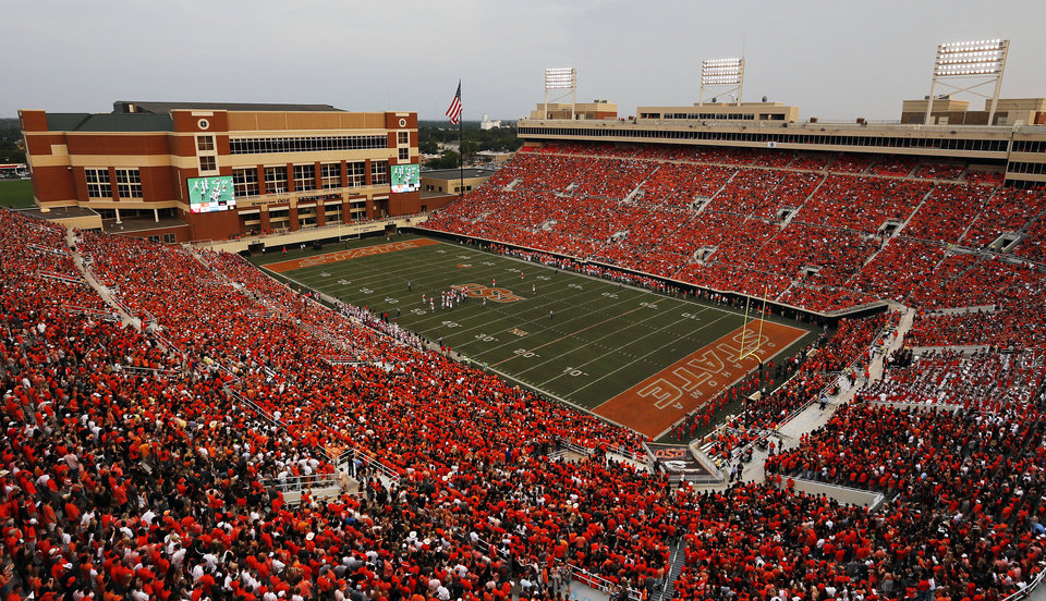 Photo - A record crowd of 59,061 attends a college football game between the Oklahoma State University Cowboys (OSU) and the Lamar University Cardinals at Boone Pickens Stadium in Stillwater, Okla., Saturday, Sept. 14, 2013. Photo by Nate Billings, The Oklahoman