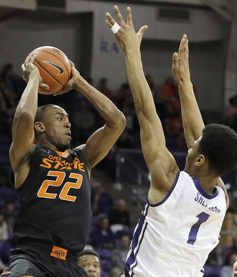 Photo - Oklahoma State guard Markel Brown (22) looks to pass as TCU Karviar Shepherd (1) defends in the first half of an NCAA college basketball game, Monday, Feb. 24, 2014, in Fort Worth, Texas. (AP Photo/Brandon Wade)