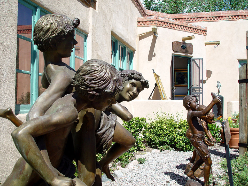 Photo - This undated image provided by the New Mexico Tourism Department shows art on display in Santa Fe's Canyon Road neighborhood. Canyon Road is home to more than 100 fine art galleries and studios that welcome visitors for free. The galleries feature everything from antiques to traditional Hispanic and Native art and international folk art. (AP Photo/New Mexico Department of Tourism)