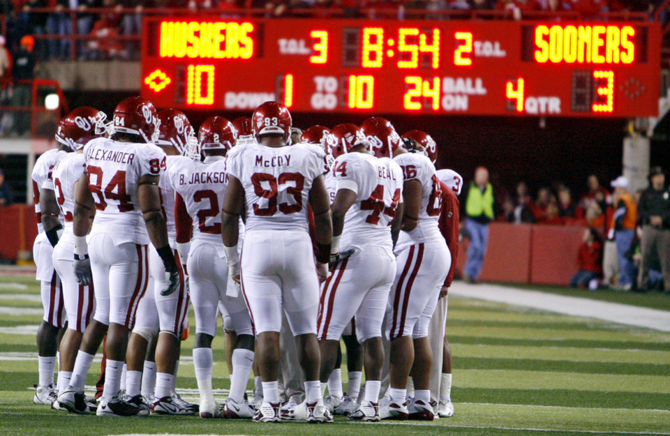 Photo - Oklahoma huddles up during the second half of the college football game between the University of Oklahoma Sooners (OU) and the University of Nebraska Cornhuskers (NU) on Saturday, Nov. 7, 2009, in Lincoln, Neb. Oklahoma lost 10-3 to Nebraska. Photo by Chris Landsberger, The Oklahoman