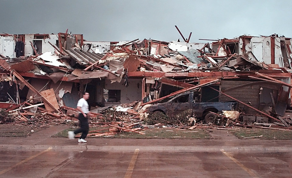 May 3, 1999, Oklahoma City Tornado:  Tornado damage: Emerald Springs Apartments, 12500 S Western in Moore across from Westmoore High School, 2nd story gone and pickup buried. A man searching for victims at the apts.  Staff Photo by Paul B. Southerland